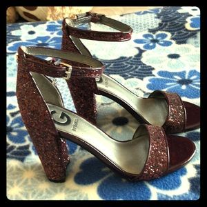 Guess open-toe design and buckled ankle strap.